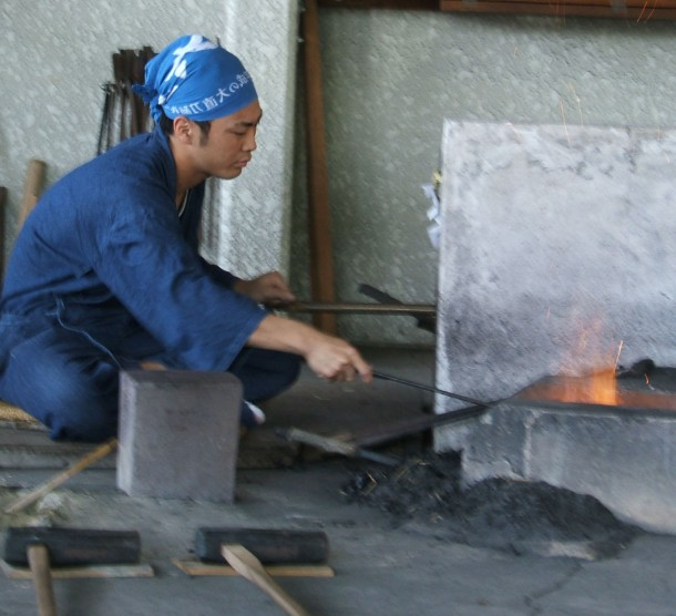 Japanese man forging a katana sword